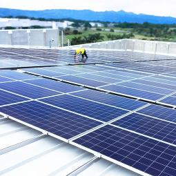 Hologic employee installing solar panels in Costa Rica