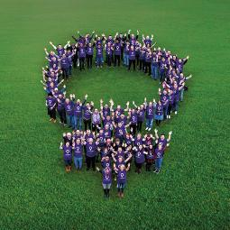 Hologic employees in women's symbol formation